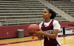 Senior Shantel Biscette prepares for a free throw during first period practice on Thursday, Dec. 10.