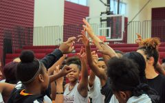 Girls' basketball players huddle together after first period practice on Wednesday, Feb. 5.