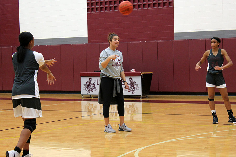 Freshmen Mya Dotson and Seimone Griffin work with coach Brittany Foster during morning practice on Wednesday, Nov. 5.