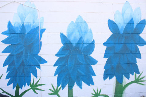 A close up view of the blue flower mural painted by senior Gloria Montellano.