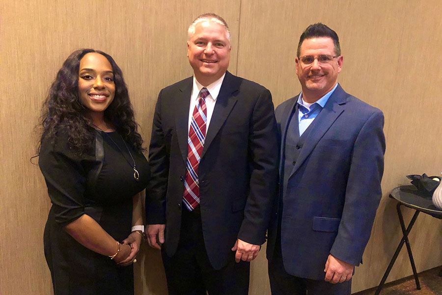Principal Jeffrey Kajs stands with Killough principal Kendra Tyler and Harmon principal Tony Fontana as he receives PTA Extended Service Award at the PTA ceremony. Courtesy of Joan Dorr.