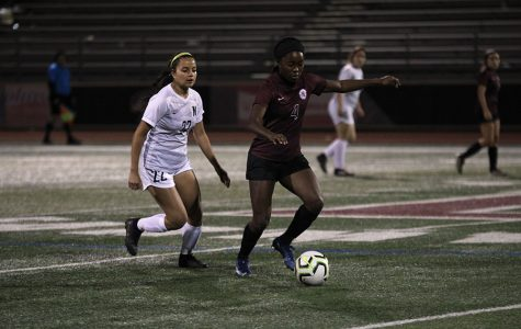 Junior Halana Stroud (4) runs after stealing the ball from the Nimitz player during the home game on Friday, March 6.