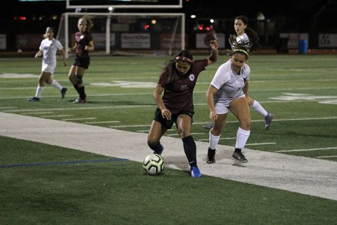 Junior Mia Espinoza (16) guards the ball from the opponent.