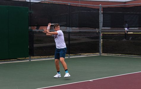 Sophomore Cooper Hopkin prepares to hit a forehand during practice on Monday, March 2.