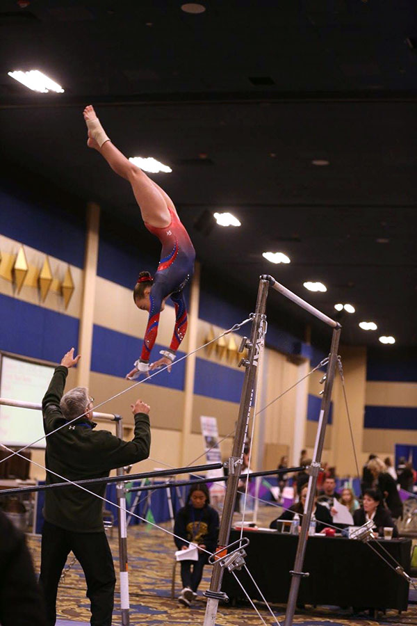 Naomi competes on bars. Courtesy of Ellie Murphy.