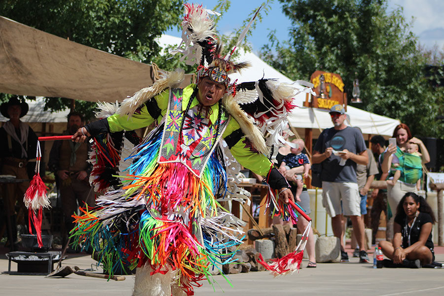 A+man+performs+an+indigenous+dance+in+front+of+the+Indigenous+Arts+Culture+and+Education+%28IACE%29+booth.