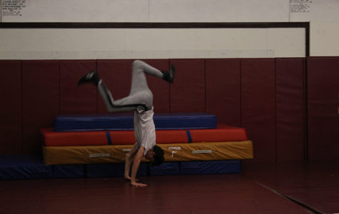 Senior Quentin Borchardt does a handspring during fourth period practice on Thursday, Nov. 21.