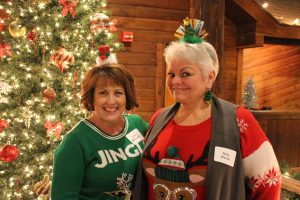 Speech and debate teachers Liana Massengale and Sally Squibb attend the 2018 staff Christmas party. Courtesy of Liana Massengale.