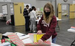 Senior Emily McGee wraps a gift for LISD's Adopt an Angel program.
